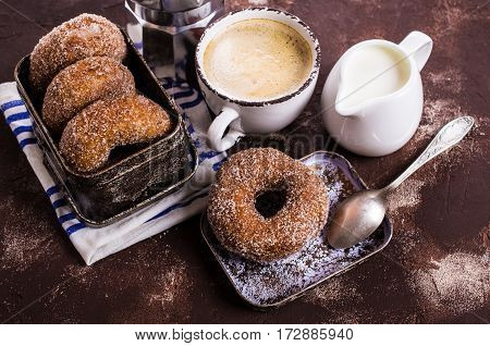 Donuts with sugar and cinnamon on a dark background. Selective focus.
