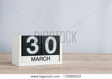 March 30th. Image of march 30 wooden color calendar on white background. Spring day, empty space for text.