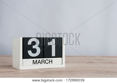 March 31st. Image of march 31 wooden color calendar on white background. Spring day, empty space for text. World Backup Day and the month end.