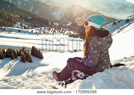 Girl Sits Looking Into The Distance Mountain Top At Sunset