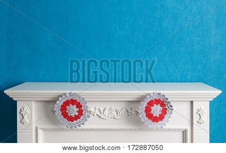 Empty decorative table-top of the fireplace decorated with two towels