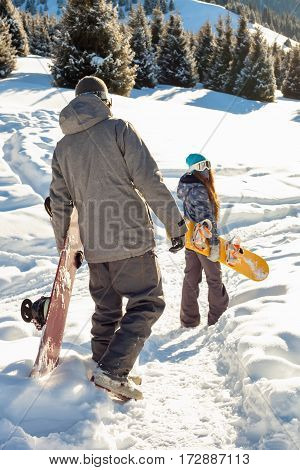 Couple Snowboarder Down The Mountain