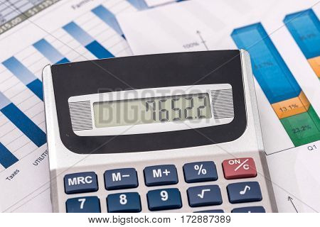 Business Concept - Financial Accounting Graphs And Charts Analysis. Counting About Cost Annual Budge