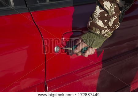 Opening lock the car with the key. Closing lock the car with the key. Men's hand puts the key into the lock of the car