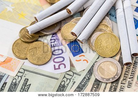 Tobacoo On Dollar And Euro Bills. Close Up.