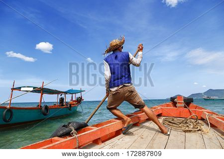 Boatman alone departs from the pier located on Rabbit island in Cambodia to send tourists to another pier