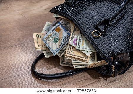 Black Woman Handbag Full Of Money, On Desk.