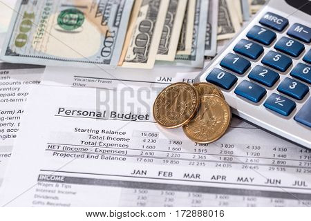 Report Of A Personal Budget With Dollars, Coins And Calculator.