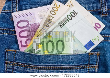 Euro Banknote Into Jeans Pocket. Close Up.
