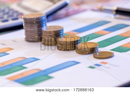 Business Graphic With Euro And Dollar, Coin, Calculator.