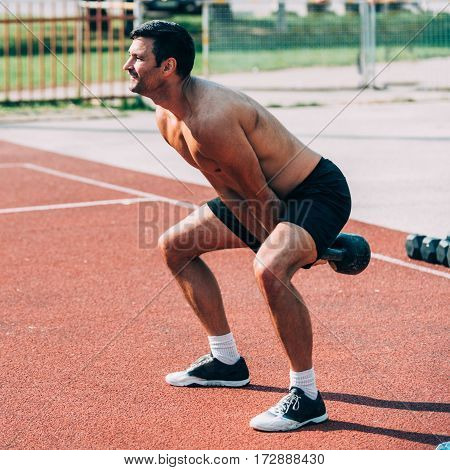 Man with kettle bell on cross  competition