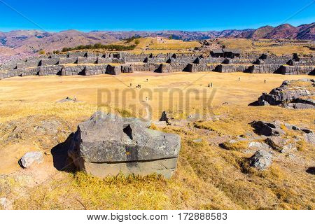 Inca Ruins - Saqsaywaman Peru South America. Archaeological complex Cuzco. Example of polygonal masonry 12 sided Hatunrumiyoc stone