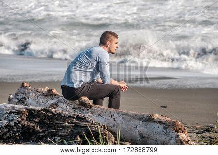 Lone man at beach, autumn. USA Pacific coast landscape, California