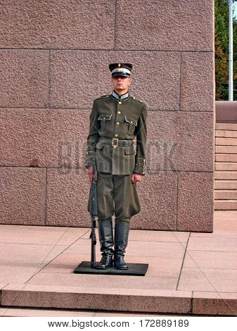Riga, Latvia - May 28, 2016:  Honorary guard  on a post near the monument in front of monument
