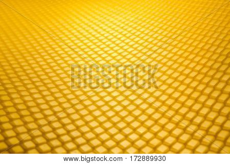 Empty honeycomb grid in perspective, brand- new beeswax, background texture