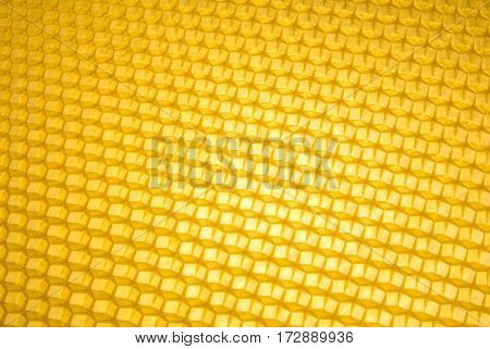 Empty honeycomb grid diagonal, brand- new beeswax, background texture