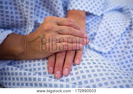 Close-up of senior patients hands in hospital room