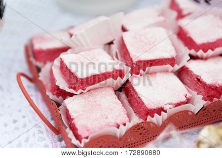 Rose turkish delight, rahat lokum. Tray with eastern sweets closeup