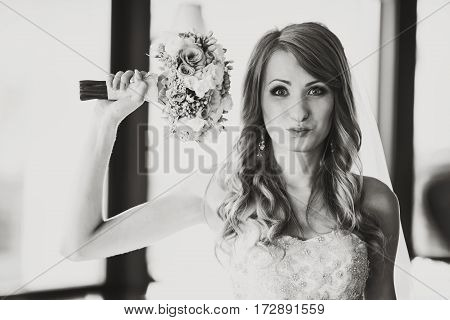 A Balck And White Picture Of A Funny Bride Posing In A Restaurant Hall