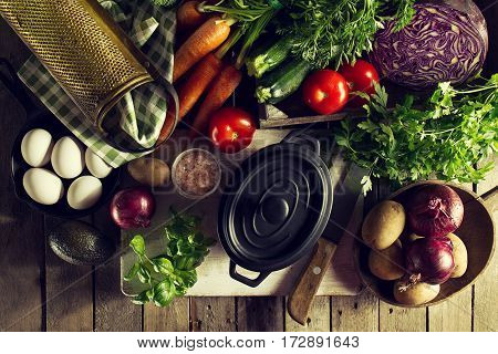 Cooking Healthy Vegetable Detox Concept with Various Vegetables Cooking Pot on Kitchen Table Kitchen Background. Top View with Copy Space.
