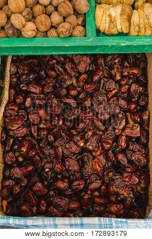 Dried dates fruit in the open street market, close up