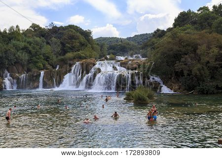 SKRADIN, CROATIA - SEPTEMBER 9. 2016: Visitors are swimming near a waterfall Skradin Buk in Krka National Nature Reserve.