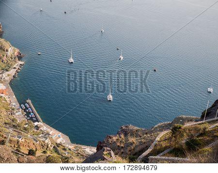 Sail boats at Santorini island in Cyclades, Greece