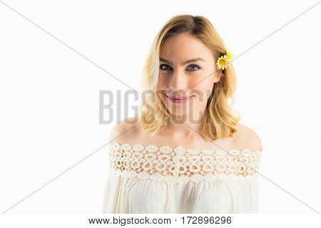 Close-up of beautiful smiling woman against white background
