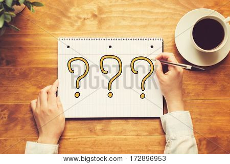 Question Mark Text With A Person Holding A Pen