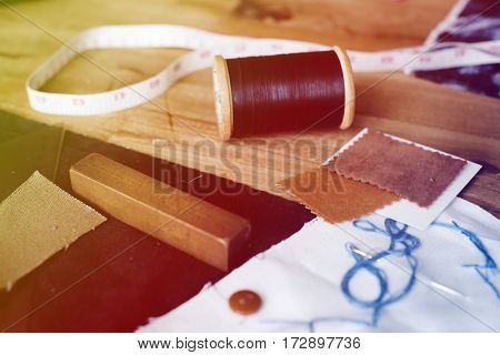 Materials Objects for costume on the wooden table