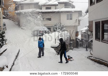 VELIKO TARNOVO BULGARIA - JANUARY 6 2017: Kids in the Old town on the cold winter day