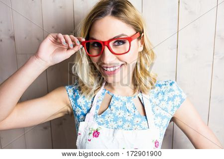 Close-up of beautiful woman posing with spectacles against texture background
