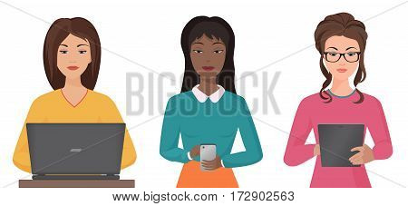 Beautiful young firls of different nationalities are using gadgets and smiling on the white background. Female gadgets communication