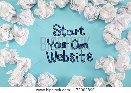Start Your Own Website Text With Crumpled Paper Balls