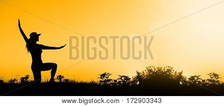 Meditation concept - website banner of a relaxing female at sunset