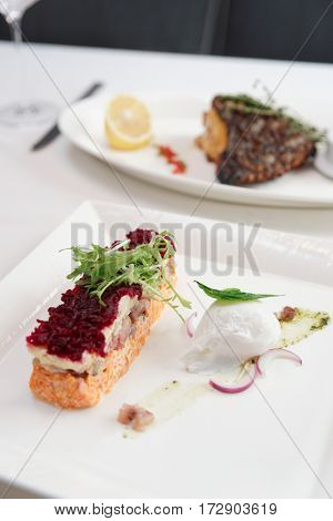 Dressed herring appetizer, traditional Russian cuisine dish, cooked in modern style