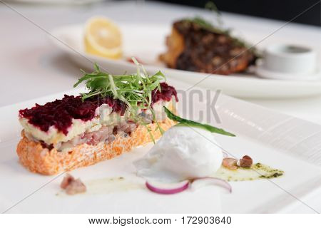 Dressed herring appetizer, traditional Russian dish, covered with layers of grated boiled vegetables, cooked with modern twist