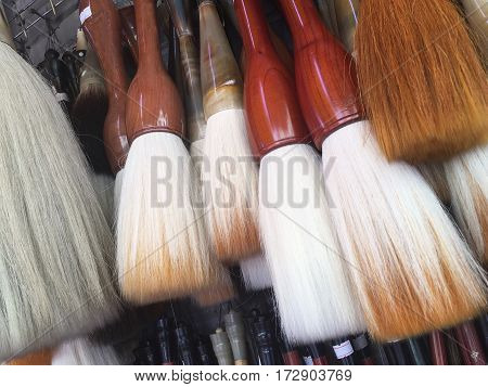 Closeup of Chinese calligraphy brushes. Set of Zen calligraphy brushes paintbrush s writing brushes use for writing Chinese Japanese Korean lettering.