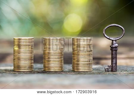 Gold money coins and a key - savings finance money concept