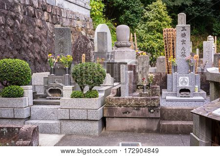 KAMAKURA, JAPAN - NOVEMBER 10, 2016: Cemetery of Hase-dera temple in Kamakura, Japan. Hase-dera Buddhist temple is famous for housing a massive wooden statue of Kannon.