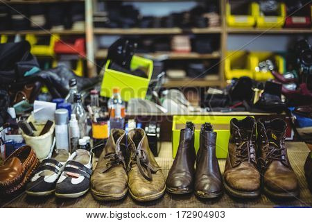 Various pair of leather shoes in workshop