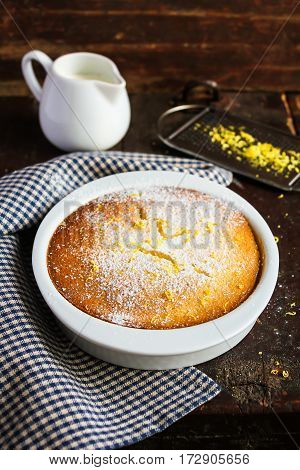Homemade lemon pudding in a bowl on a wooden rustic table, selective focus