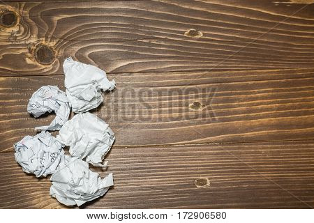 Crumpled Paper Ball Isolated On A Brown Table