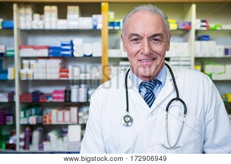 Portrait of pharmacist with a stethoscope in pharmacy