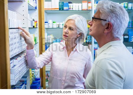 Customers checking medicines in pharmacy