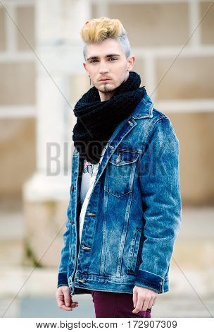 Man wearing bohemian chic clothing posing on the street