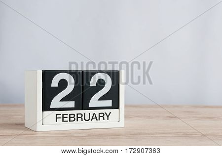February 22nd. Day 22 of month, calendar on wooden background. Winter concept. Empty space for text.