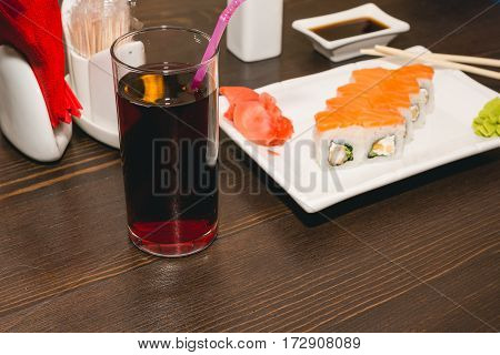 Sushi With The Chinese Sticks Lie On A Table. Japanese Cuisine.