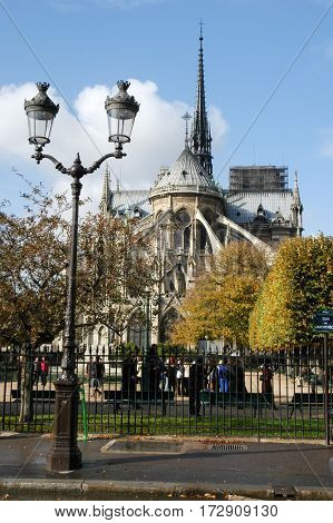 People Walking In Front Of The Cathedral Notre Dame At Paris