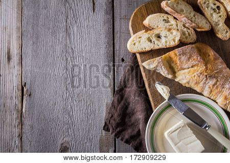 French baguette with butter and coffee for breakfast